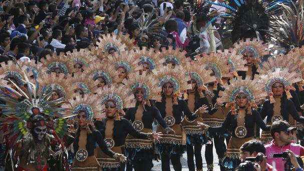 People perform during the first Day of the Dead parade in Mexico City (AP)