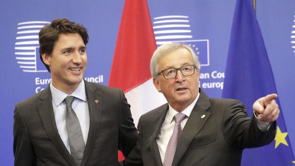 European Commission President Jean-Claude Juncker, right, and Canadian Prime Minister Justin Trudeau have signed the agreement (AP)