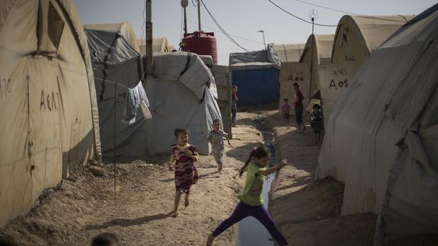 Children play in the Yahyawa camp for internally displaced Turkmen on the outskirts of Kirkuk, Iraq (AP)