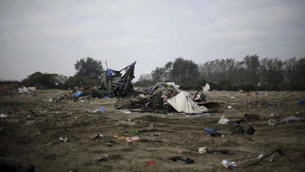 The remains of the makeshift migrant camp known as