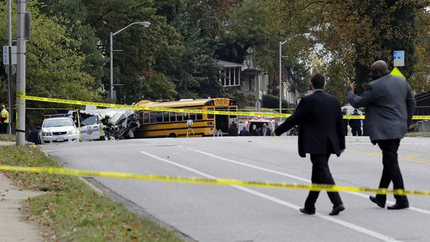 Officials approach the scene of the crash (AP)