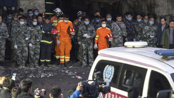 Rescuers mourn victims of the mine explosion (Xinhua/AP)
