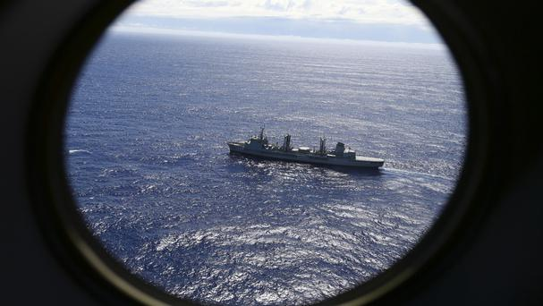 HMAS Success scans the southern Indian Ocean, near the coast of Western Australia, as a Royal New Zealand Air Force P3 Orion flies over in the search for missing Malaysia Airlines Flight MH370 (AP)