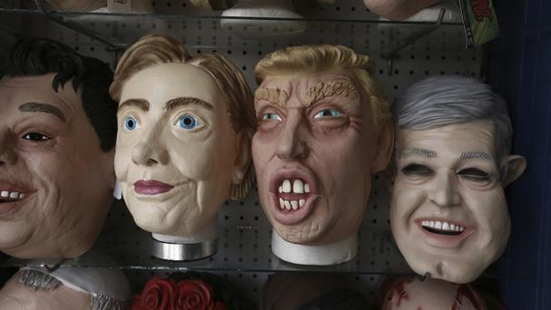 Masks of the US presidential candidates Hillary Clinton and Donald Trump on display (AP)