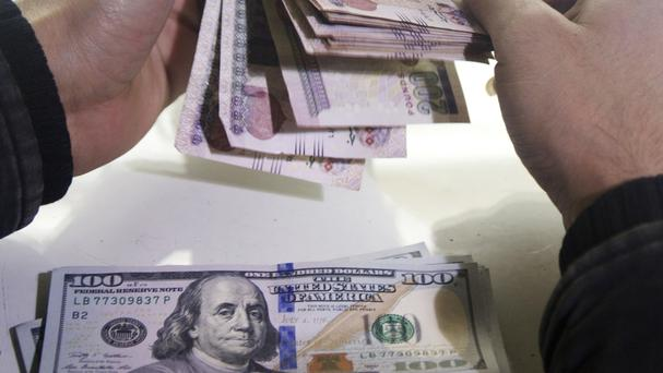 The move by the Egyptian Central Bank followed a plunge in the value of the pound against the US dollar (AP)