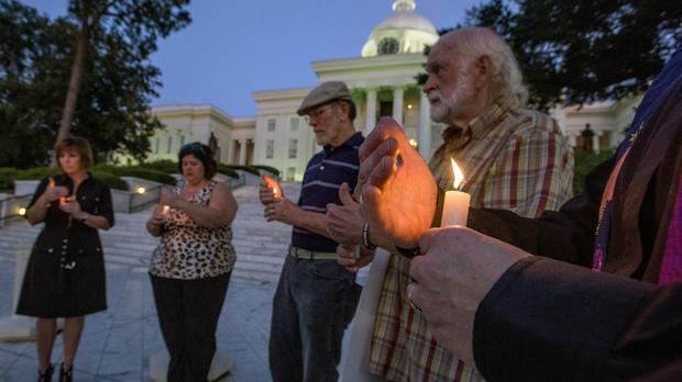 People stage a candlelight vigil for convicted murderer Tommy Arthur on the steps of the Alabama capitol building in Montgomery (The Montgomery Advertiser/AP)