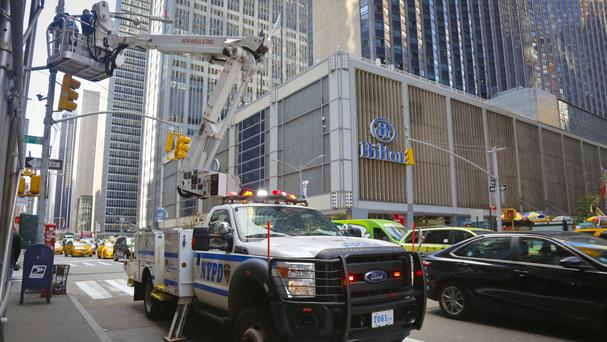 NYPD workers install security cameras near the Hilton in New York City (AP)