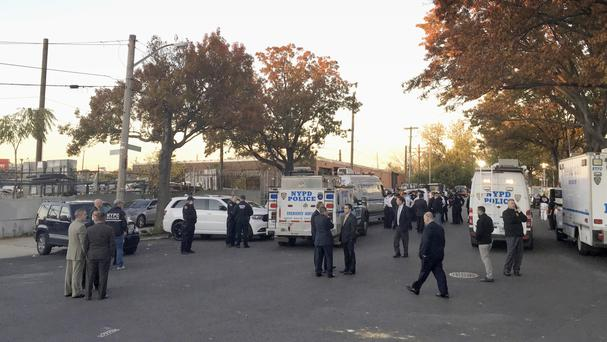 Police officers gather at a shooting scene in the Bronx borough of New York (AP)