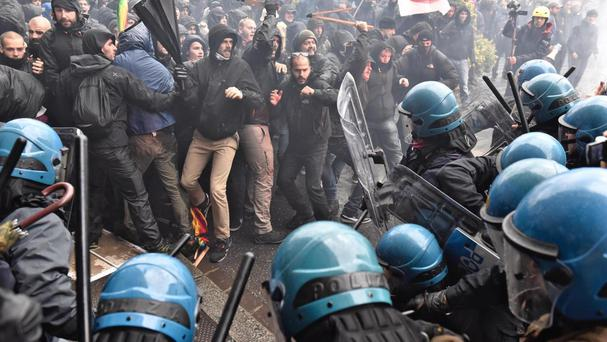Demonstrators clash with police during a protest in Florence, Italy (AP)