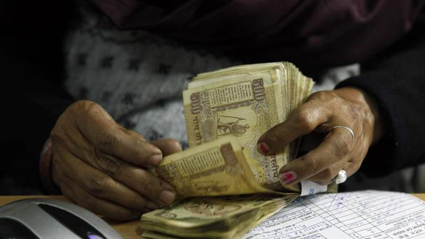 India is scrapping high denomination 500 and 1,000 rupee notes. (AP)