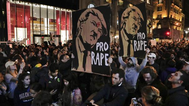 Protesters in New York march along Fifth Avenue outside Trump Tower, to protest against Donald Trump's presidential victory (AP)