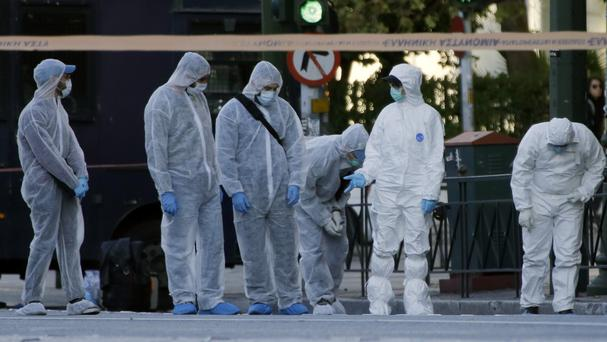 Police search for evidence after an explosion outside the French embassy in Athens (AP)