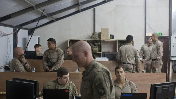 US military personnel work out of the Combined Joint Operations Centre in Qayara, south of Mosul (AP)