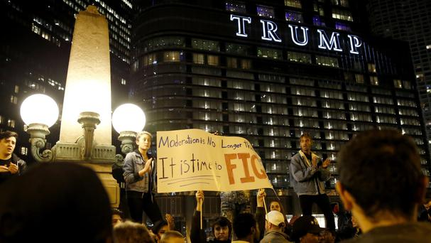 Protesters gather in Chicago as they demonstrate against the election of President-elect Donald Trump (AP)