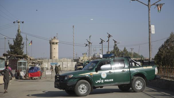 Afghan sceurity forces block the main road to the Bagram Airfield's main gate. (AP)