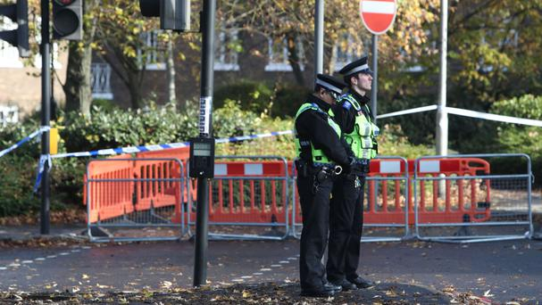 Police officers at the site of the Croydon tram crash pay their respects