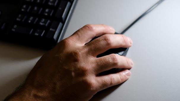 From scissors to corkscrews and playing cards to pens - even modern technology designs apps for right-handers and locates buttons on the right side of computers so your left hand blocks the screen (Stock picture)