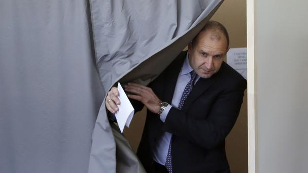Bulgarian Socialists Party candidate Rumen Radev leaves the polling booth (AP)