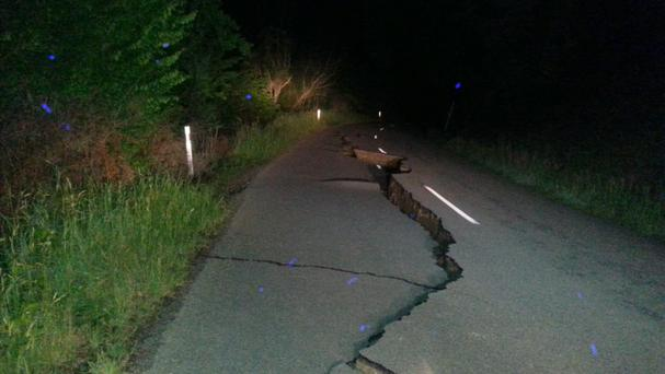 A large fissure runs along Kaikoura Road about two hours north of Christchurch (AP)
