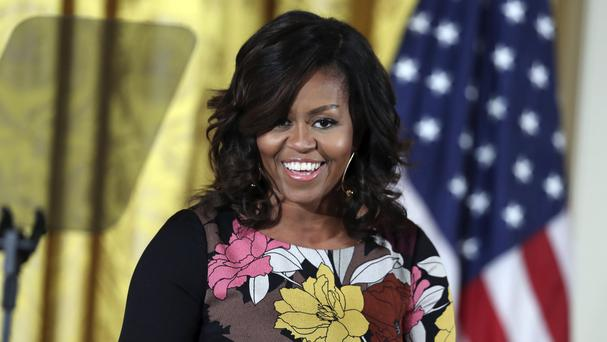 The director and the mayor have been urged to step down over remarks about Michelle Obama (AP)