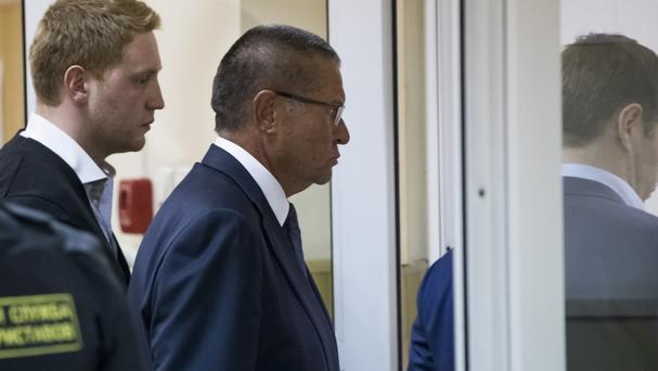 Alexei Ulyukayev is escorted to a courtroom in Moscow (AP)