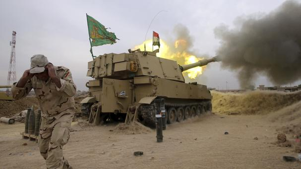 Iraqi troops fire a 155mm shell towards Islamic State positions in Mosul (AP)