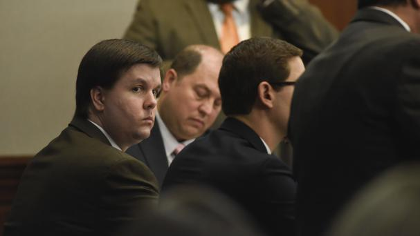 Justin Ross Harris sits with his defence team in the Glynn County Courthouse (AP)