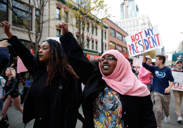Local students and their supporters march during a walkout protest against US president-elect Donald Trump in Seattle. Photo: Jason Redmond/Getty Images