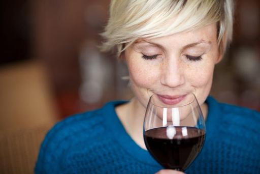 Red wine slows down ageing enzyme triggered by smoking. Picture posed