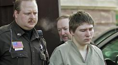 Brendan Dassey being escorted out of a Manitowoc County Circuit courtroom in Wisconsin (AP)