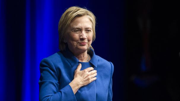 Hillary Clinton places her hand over her hand as she walks to the podium to address the Children's Defence Fund's Beat the Odds celebration (AP)