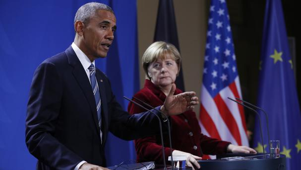 President Barack Obama and German chancellor Angela Merkel participate in a news conference in Berlin (AP)
