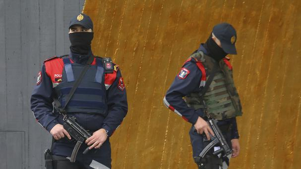 Albanian special police guard a hotel where the Israeli football team were staying, ahead of a World Cup qualifier (AP)