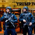 New York Police officers stand guard at the entrance of Trump Tower, in New York. Photo: AFP/Getty Images