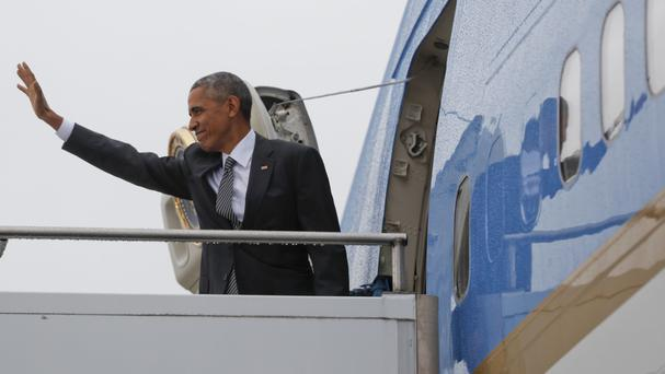 US president Barack Obama waves as he boards Air Force One during his departure from Berlin (AP)