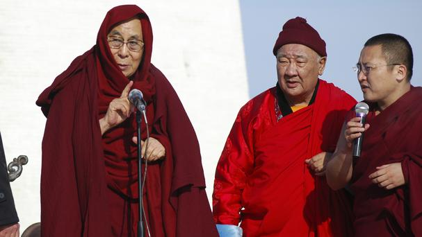 The Dalai Lama, left, speaks at the Gandantegchinlen monastery in Mongolia (AP)