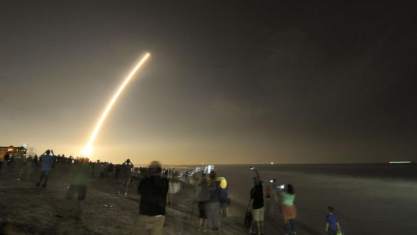 Mobile phones light up the beaches of Cape Canaveral and Cocoa Beach, Florida, as spectators watch the launch of the NOAA GOES-R weather satellite (Malcolm Denemark/Florida Today via AP)