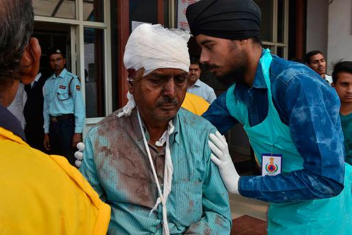 An injured Indian passenger is treated at a hospital in Kanpur. Photo: Getty