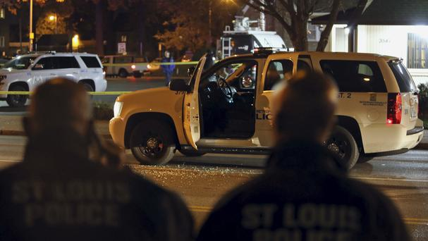 Police investigate the scene where a St Louis police officer was shot (David Carson/St Louis Post-Dispatch via AP)