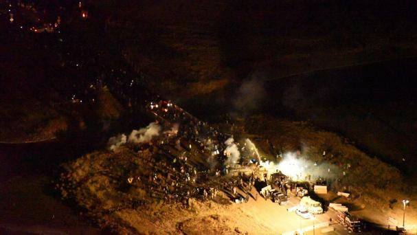 Police and protesters clash near the site of the Dakota Access pipeline. (Morton County Sheriffs' Department via AP)