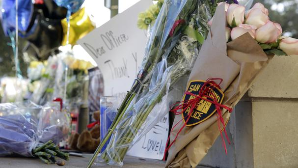 Flowers, balloons and notes are placed at a makeshift memorial for San Antonio police officer Benjamin Marconi (AP)