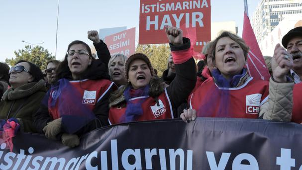 Thousands of members of Turkey's main opposition Republican People's Party march to the parliament in Ankara (AP)