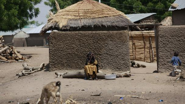 Hundreds of people have fled as the insurgents loot and burn in the Chibok area (AP)