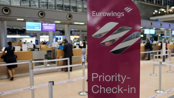 The check-in counters of Eurowings at Helmut Schmidt Airport in Hamburg (AP)