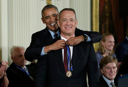 Tom hanks receives his medal. Photo: Reuters