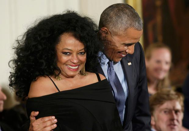 Singer Diana Ross is hugged by U.S. President Barack Obama