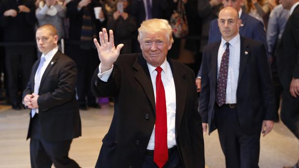 President-elect Donald Trump waves to the crowd as he leaves the New York Times building (AP)