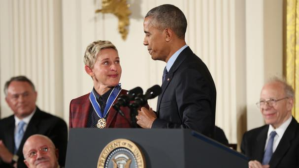 Ellen DeGeneres glances at President Barack Obama as she is presented the Presidential Medal of Freedom (AP)