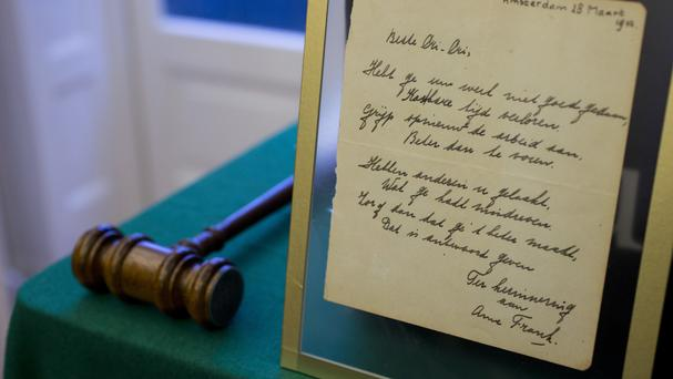 Poem signed by Anne Frank sells for nearly $150000
