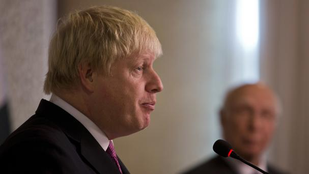 Boris Johnson addresses a news conference in Islamabad (AP)